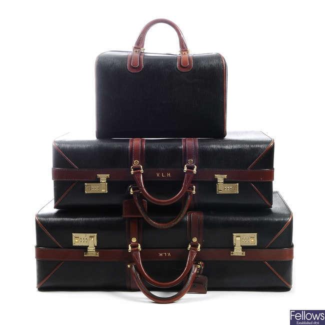 ASPREY - a set of three vintage bespoke travel cases.