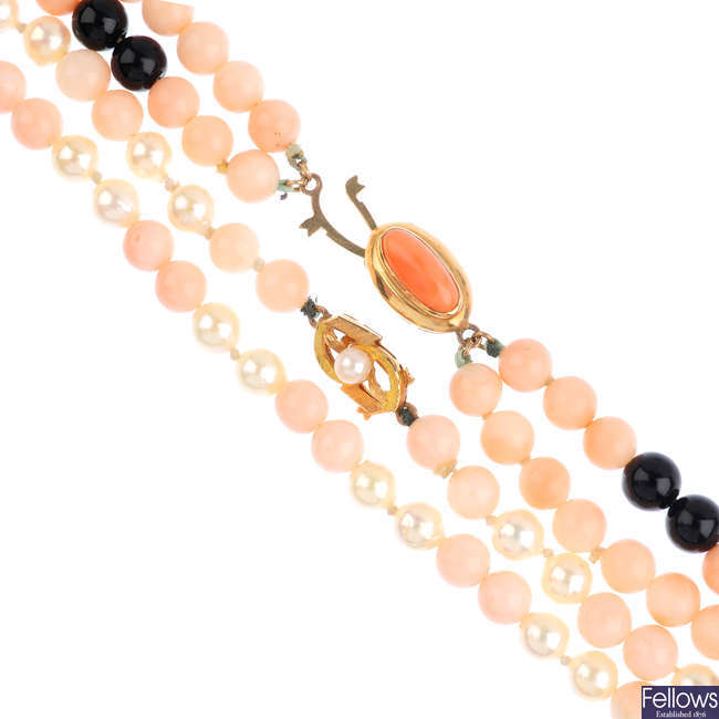Two cultured pearl and coral necklaces.
