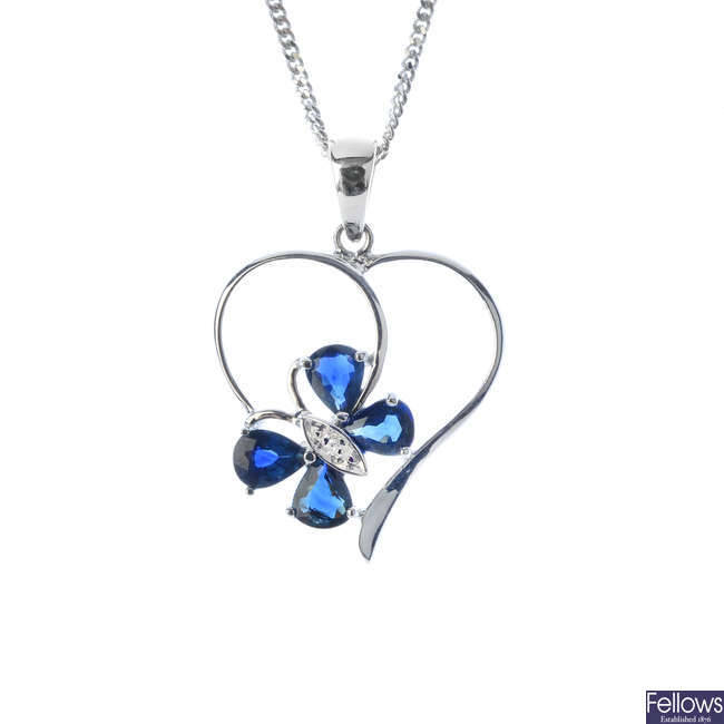 A 9ct gold sapphire and diamond pendant, with 9ct gold chain.