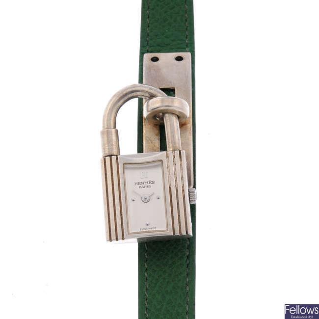 HERMÈS - a lady's silver Kelly wrist watch.