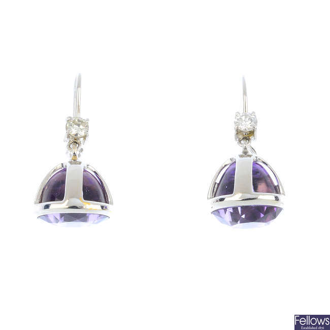 A pair of diamond and amethyst earrings.