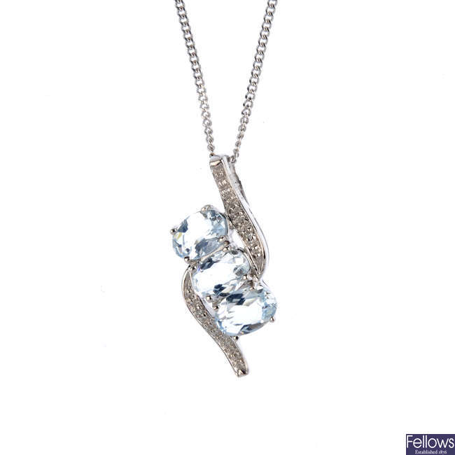 A 9ct gold aquamarine and diamond pendant, with a 9ct gold chain.