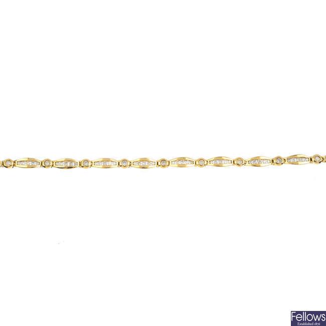 A 9ct gold diamond bracelet.