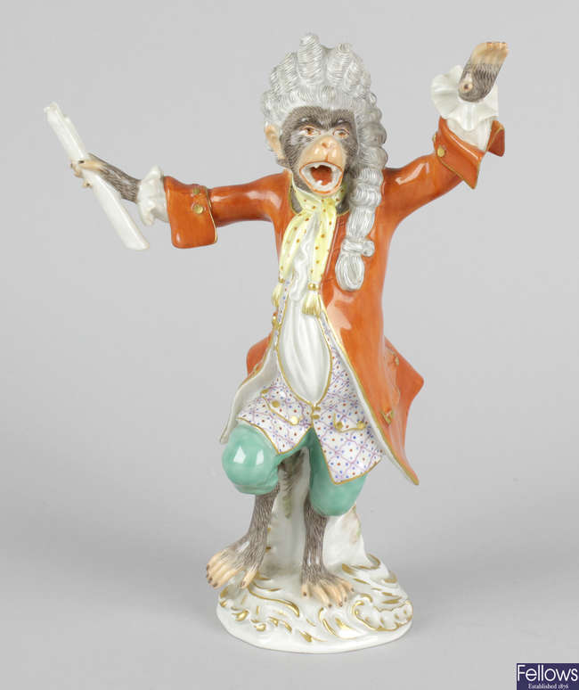 A 20th century Meissen monkey band conductor.