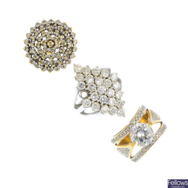 Seven 9ct gold gem-set rings.
