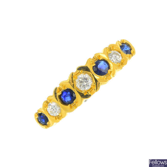 An 18ct gold diamond and sapphire ring.