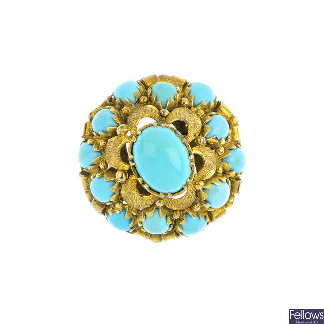 A reconstituted turquoise dress ring.