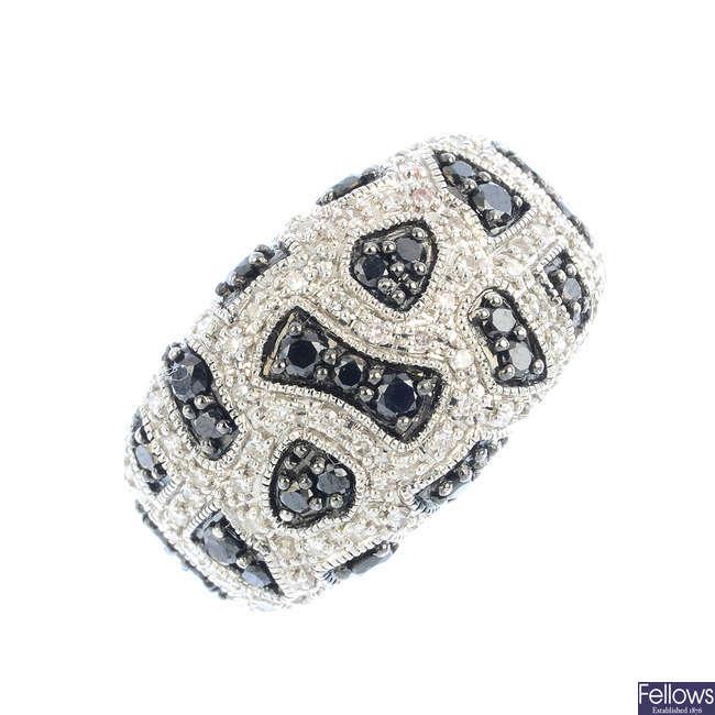 A 9ct gold diamond and black-gem dress ring.