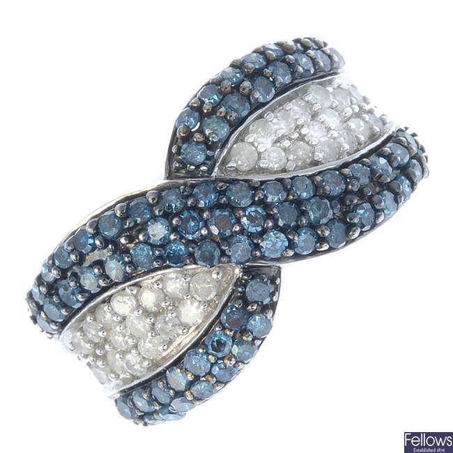A 9ct gold 'coloured' diamond and diamond dress ring.
