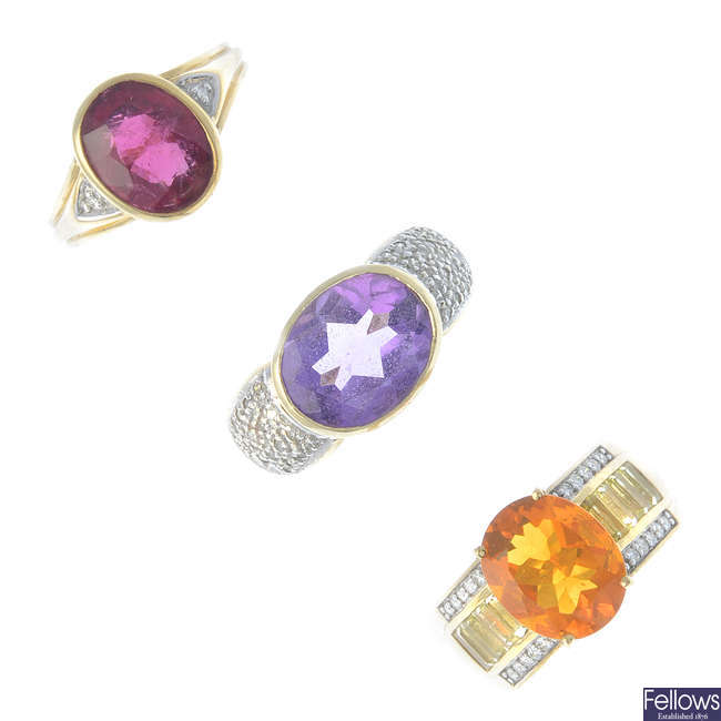 Three 9ct gold diamond and gem-set dress rings.