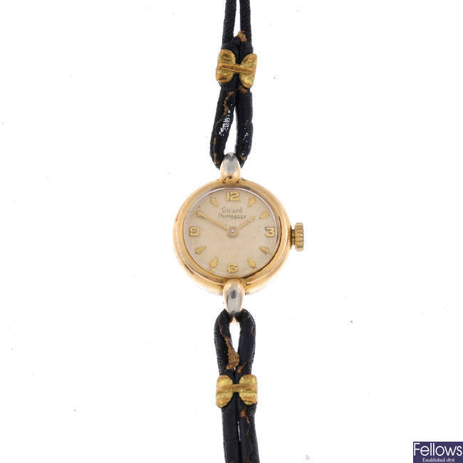 GIRARD-PERREGAUX - a lady's gold plated wrist watch with a 9ct gold wrist watch.