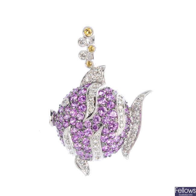 A sapphire and diamond fish pendant.