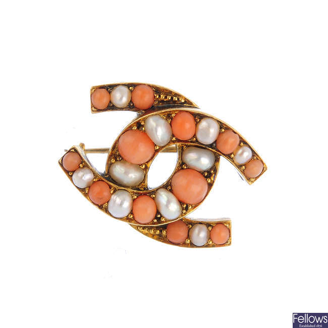 A late Victorian gold, coral and split pearl horseshoe brooch.