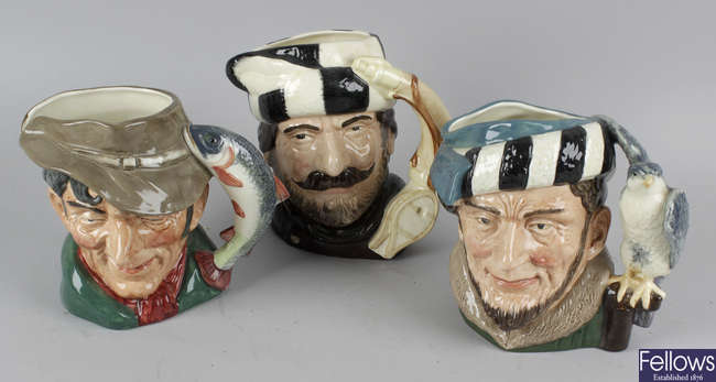 A group of eleven Royal Doulton character jugs