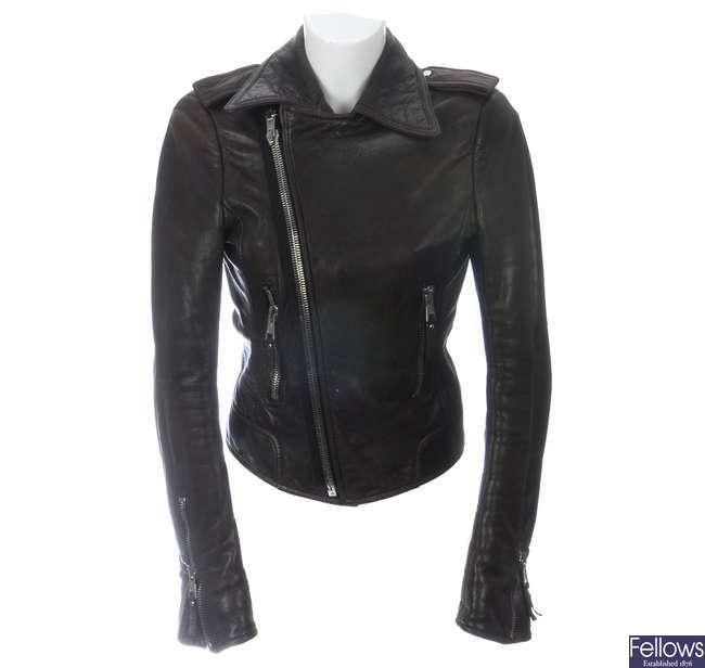 BALENCIAGA - a brown leather biker jacket.