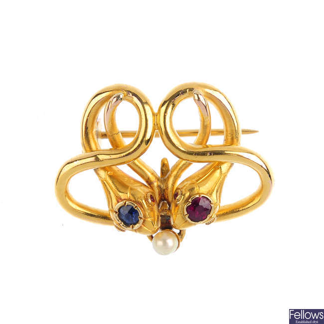 A late Victorian 18ct gold, sapphire, ruby and seed pearl snake brooch.