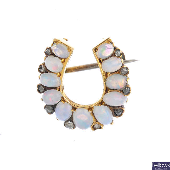 A late Victorian 15ct gold, opal and diamond horseshoe brooch.