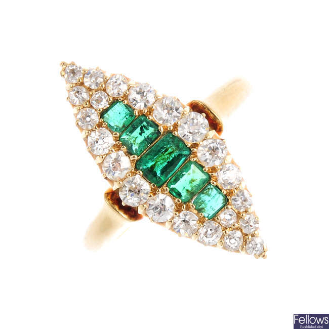 An Edwardian 18ct gold emerald and diamond cluster ring.