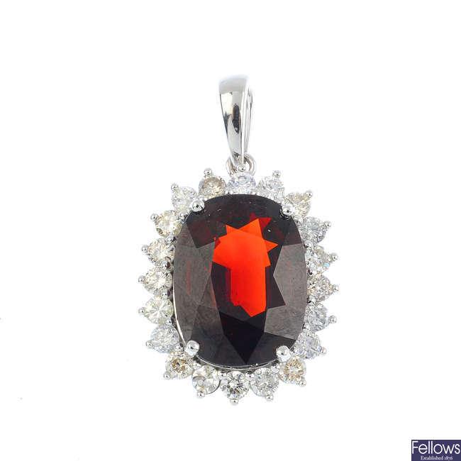A garnet and diamond cluster pendant.