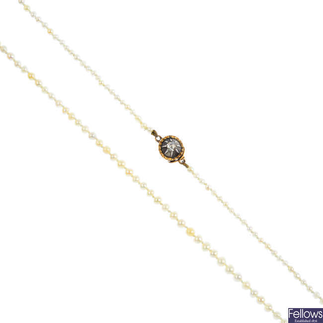 A natural seed pearl single-strand necklace, with diamond clasp.