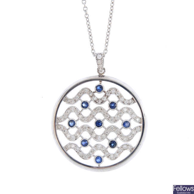 A diamond and sapphire pendant, with chain.