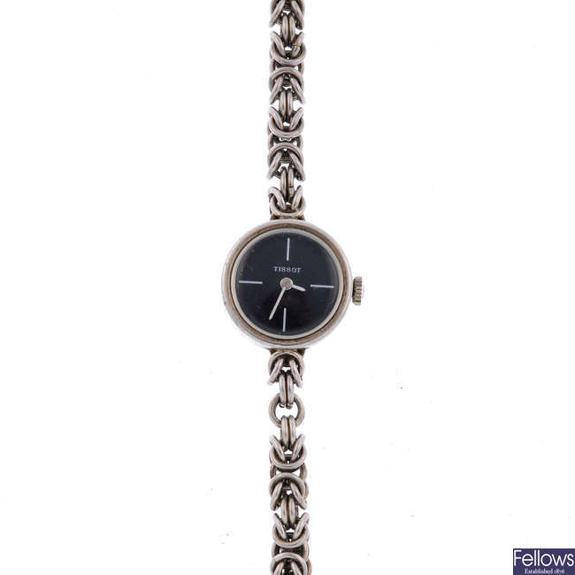 TISSOT - a lady's silver bracelet watch.