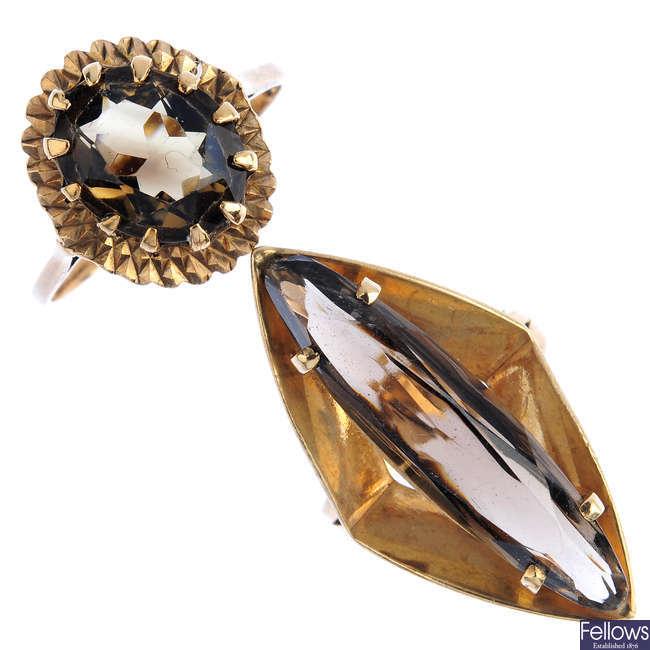 Eight gold gem-set rings.