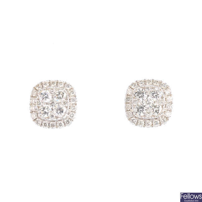 A pair of 18ct gold diamond cluster earrings.