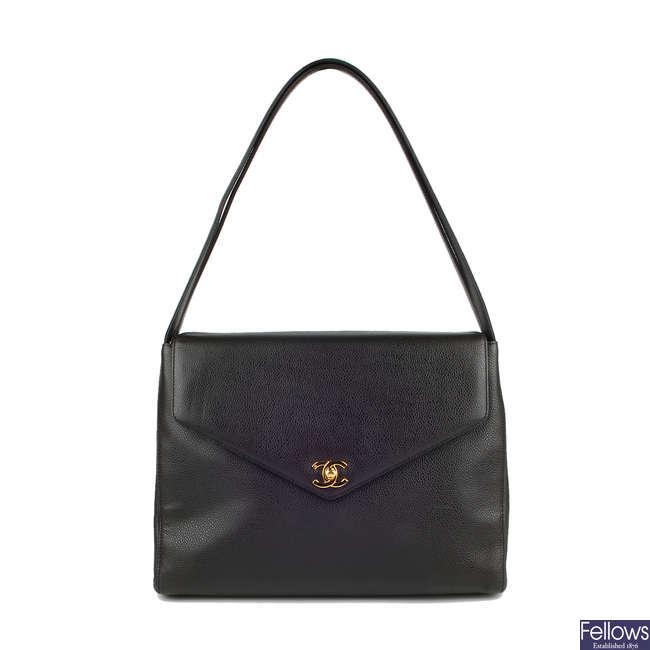 CHANEL - a 90s Caviar leather handbag.
