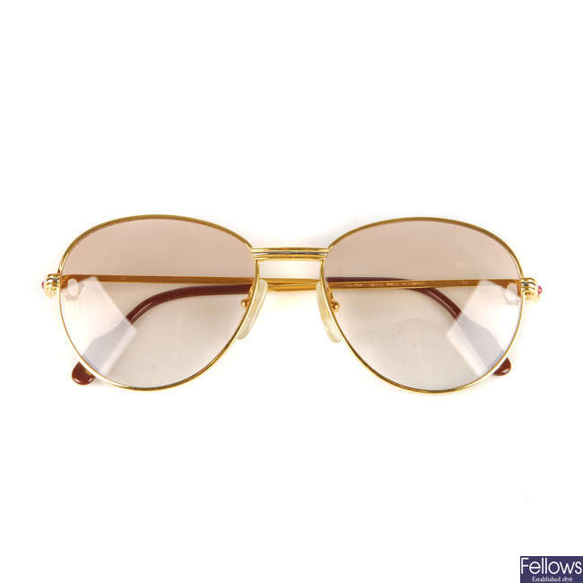 CARTIER - a pair of rose tinted sunglasses.