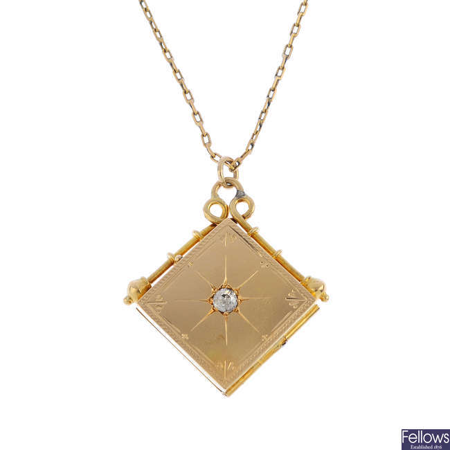 An early 20th century 18ct gold diamond locket, with chain.