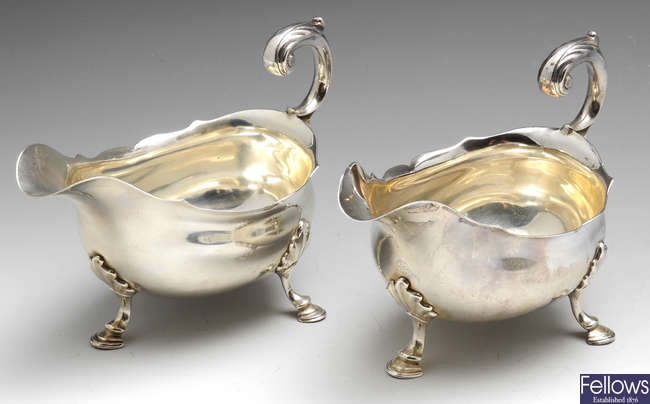 A pair of George II silver sauce boats by David Hennell I.
