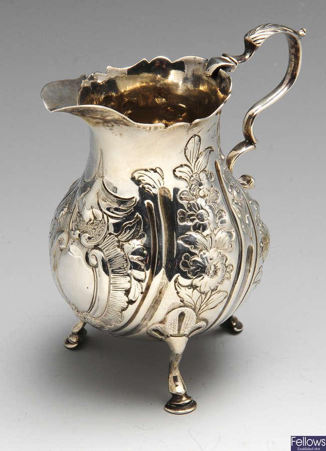 An early George III silver cream jug.