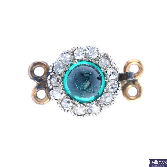 An early 20th century emerald and diamond cluster clasp.