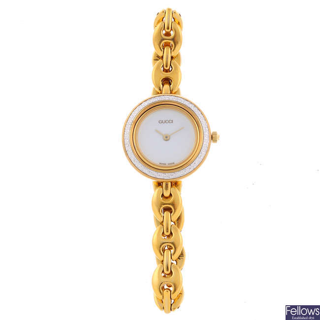 GUCCI - a lady's gold plated bracelet watch.