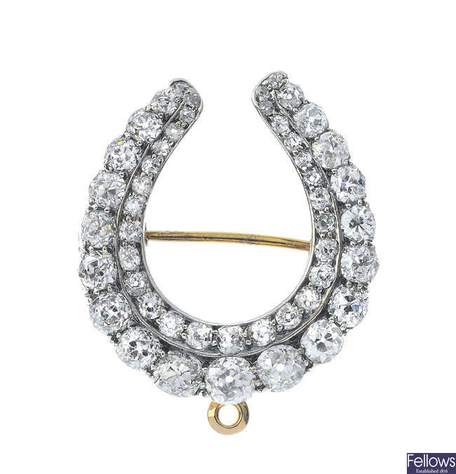 A late Victorian silver and 9ct gold diamond horseshoe brooch.