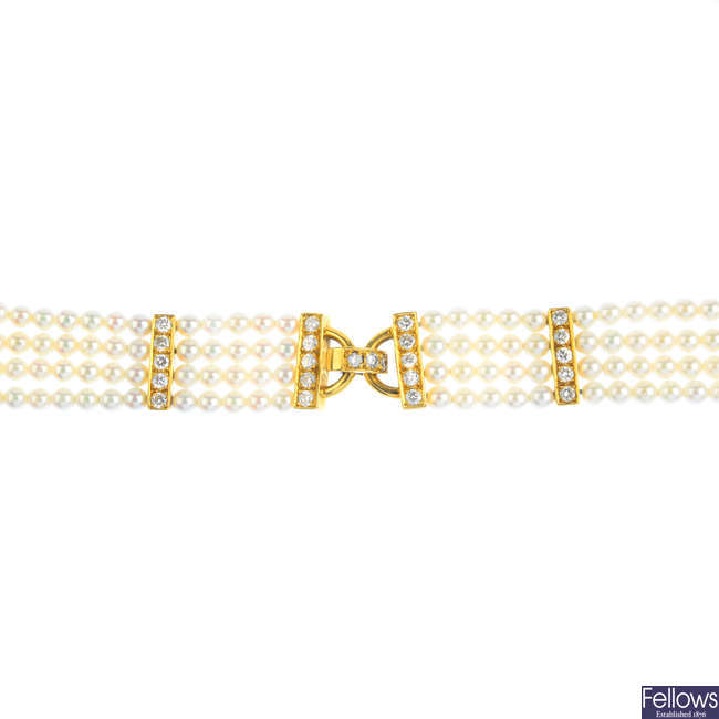 An 18ct gold seed pearl and diamond bracelet.