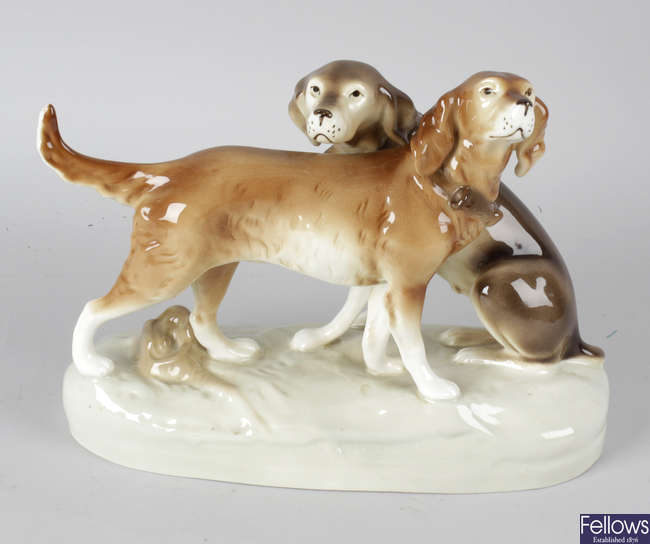 A Royal Dux Czechoslovakian ornament modelled as two gun dogs.