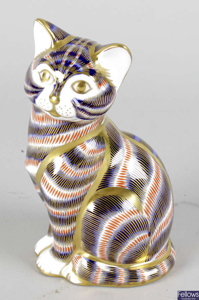 A Royal Crown Derby porcelain paperweight modelled as a seated kitten.