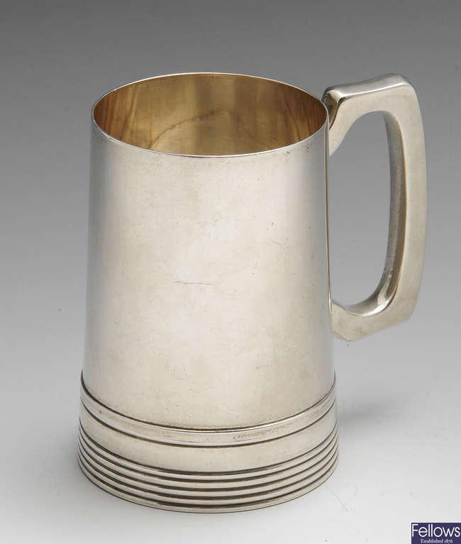 A mid-twentieth century silver mug.