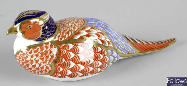 A Royal Crown Derby porcelain paperweight modelled as a pheasant.