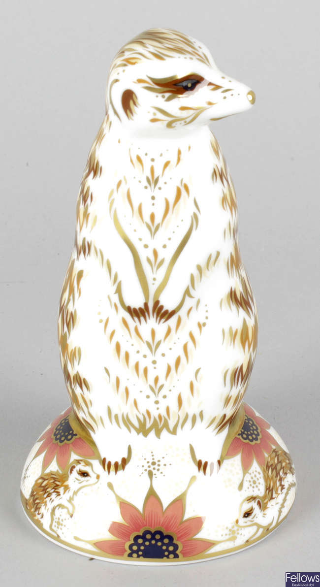 A Royal Crown Derby porcelain paperweight modelled as a meerkat.