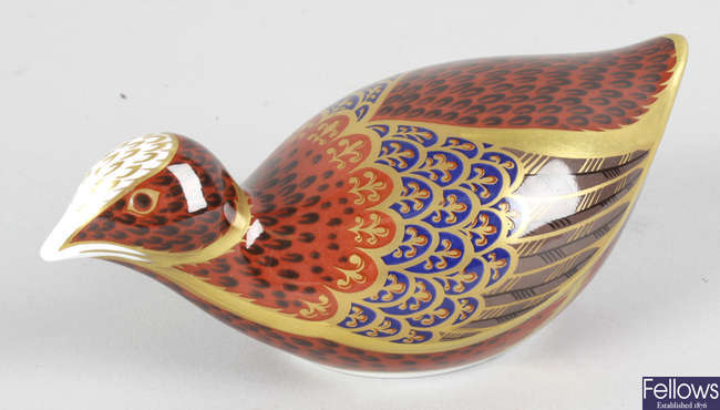 A Royal Crown Derby porcelain paperweight modelled as a quail.