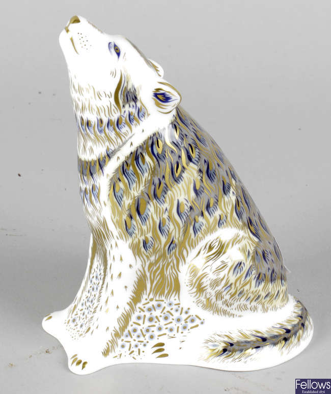 A Royal Crown Derby porcelain paperweight modelled as a wolf.