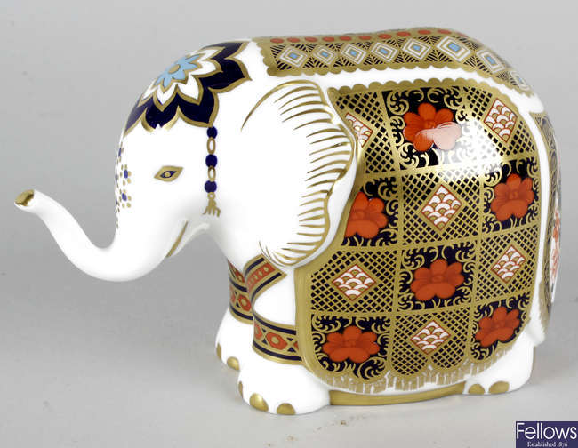 A Royal Crown Derby porcelain paperweight modelled as an elephant.