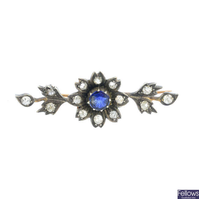 A late Victorian silver and gold, sapphire and diamond floral brooch.