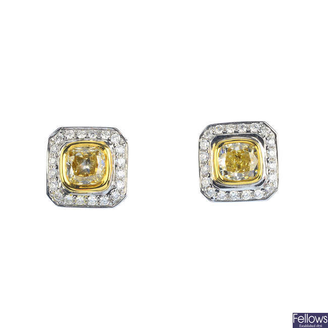 A pair of 18ct gold 'yellow' diamond and diamond cluster earrings.