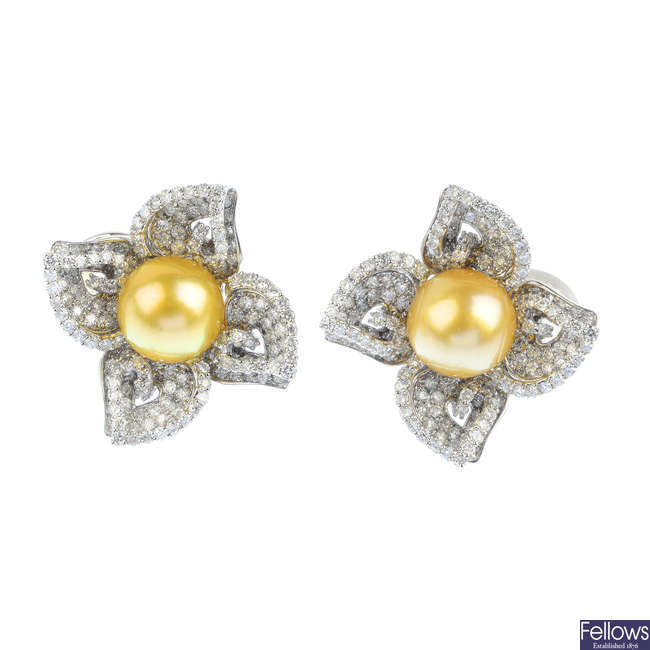 A pair of diamond and cultured pearl floral earrings.