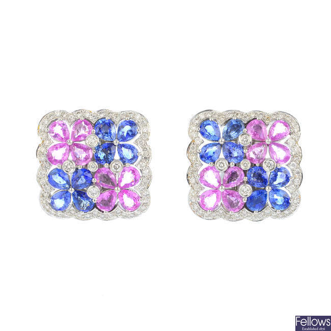 A pair of sapphire and diamond floral earrings.