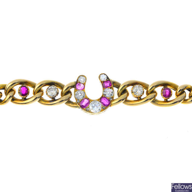 A late Victorian gold, diamond and ruby horseshoe bracelet.